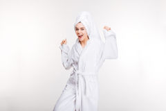 Happy excited woman dancing in bathrobe with towel on head Stock Photos