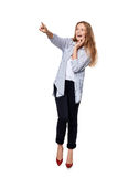 Happy excited woman in full length pointing to the side Royalty Free Stock Photos