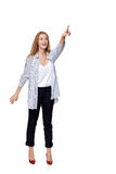 Happy excited woman in full length pointing to the side Royalty Free Stock Image