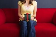 Happy excited woman holding a gift. Royalty Free Stock Photo