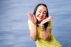 Happy and excited woman holding her face Royalty Free Stock Image