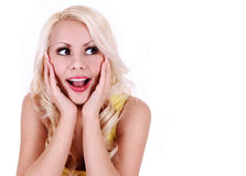 Happy excited woman looking up and screaming. cheerful beautiful blonde young woman isolated. On white Royalty Free Stock Photo