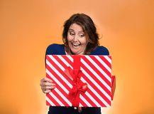 Happy excited woman opening red gift box Royalty Free Stock Photo