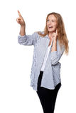 Happy excited woman pointing to the side Royalty Free Stock Photo