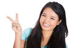 Happy, excited woman showing a peace sign Stock Photo