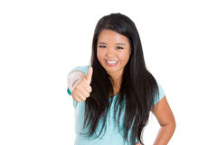 Happy, excited woman showing a thumbs up sign Stock Photography