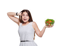 Happy excited woman shows fresh vegetable salad isolated on white Stock Images