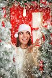 Happy and excited woman on snowfall background Christmas tree Stock Image