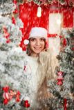 Happy and excited woman on snowfall background Christmas tree Royalty Free Stock Images