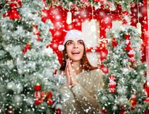 Happy and excited woman on snowfall background Christmas tree Royalty Free Stock Photography