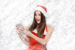 Happy excited woman in snowflakes holding tablet Royalty Free Stock Photography