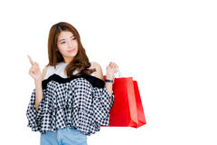 happy excited woman standing and holding colorful shopping bags Stock Photos