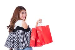 Happy excited woman standing and holding colorful shopping bags isolated. Royalty Free Stock Photo