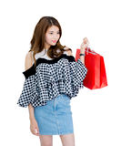 Happy excited woman standing and holding colorful shopping bags. Royalty Free Stock Photo