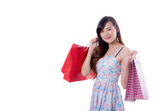 Happy excited woman standing and holding hopping bags. Royalty Free Stock Photos