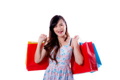 happy excited woman standing and holding shopping bags Royalty Free Stock Photography