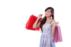 happy excited woman standing and holding shopping bags. Stock Photo