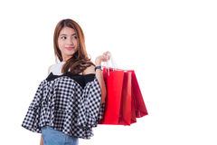 happy excited woman standing and holding shopping bags. Royalty Free Stock Photo