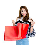 happy excited woman standing and holding shopping bags. Royalty Free Stock Images