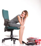 Happy excited young businesswoman, relaxing in office chair, rel Royalty Free Stock Photography