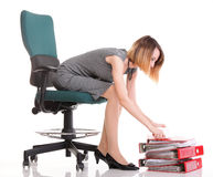 Happy excited young businesswoman, relaxing in office chair, rel Royalty Free Stock Image