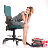 Happy excited young businesswoman, relaxing in office chair, rel Stock Photography