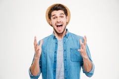 Happy excited young man celebrating success and shouting. Over white background Stock Image