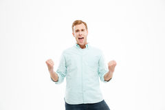Happy excited young man standing and celebrating success Royalty Free Stock Photos