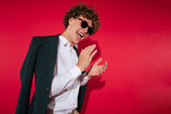 Happy excited young man in white shirt and jacket celebrating Stock Images