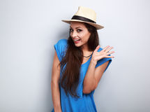 Happy excited young woman in blue top and summer hat looking on Royalty Free Stock Image