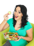 Happy Excited Young Woman Eating a Fresh Crisp Mixed Garden Salad Stock Image