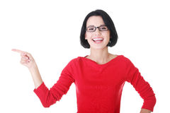 Happy , excited young woman pointing on copy space Stock Photography