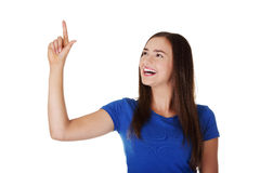 Happy , excited young woman pointing on copy space Stock Photos
