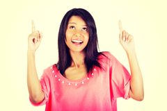 Happy , excited young woman pointing on copy space Stock Photo