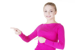 Happy , excited young woman pointing on copy space Royalty Free Stock Images