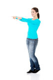 Happy , excited young woman pointing on copy space Royalty Free Stock Photography