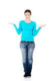 Happy , excited young woman presenting copy space on her palm Royalty Free Stock Photos