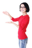Happy , excited young woman presenting copy space on her palm Stock Photos