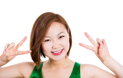 Happy excited young woman showing the sign of victory Stock Photography