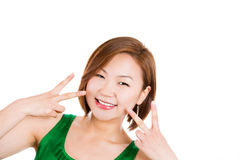 Happy excited young woman showing the sign of victory Stock Photos