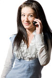 Happy excited young woman talking on the phone. Happy excited young brunette woman talking on the cell-phone Stock Image