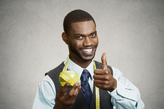 Happy executive advising on healthy diet, holding green apple stock photos