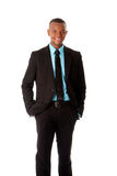 Happy Executive corporate business man. Happy handsome successful executive corporate business man manager foreman standing with hands in pocket, isolated royalty free stock photo