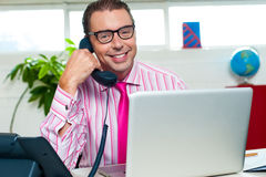 Happy executive engaged on a business call Stock Photos