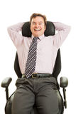 Happy Executive in Ergonomic Chair. Happy smiling businessman enjoying his new ergonomic office chair.  Isolated on white Royalty Free Stock Image