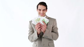 Happy executive holding a fan of notes Stock Photography