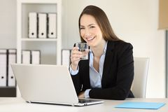 Executive holding a glass of water and looking at you Stock Photography
