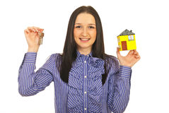 Happy executive holding home and keys Royalty Free Stock Image