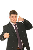 Happy executive male gesturing call me Royalty Free Stock Photography