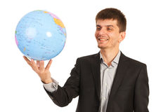 Happy executive man holding world globe Stock Photos